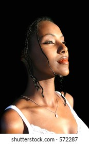 Beautiful african american woman on black background