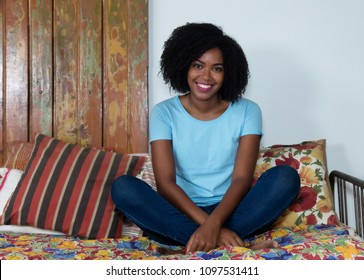 Beautiful african american woman relaxing indoor at home