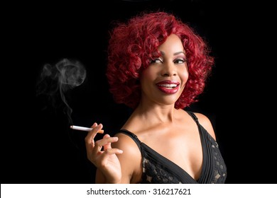 Beautiful african american woman smoking cigarette