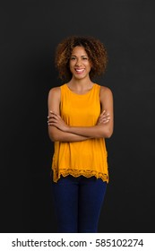 Beautiful African American woman standing with hands folded