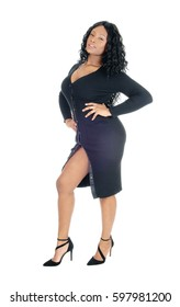 A beautiful African American woman standing in a black dress and heels