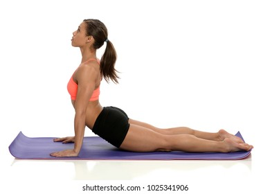 Beautiful African American woman stretching doing yoga excercise isolated over white background