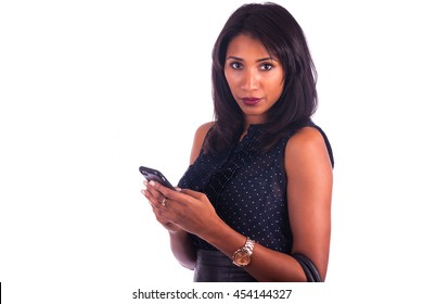 Beautiful African American woman talking on cell phone, isolated