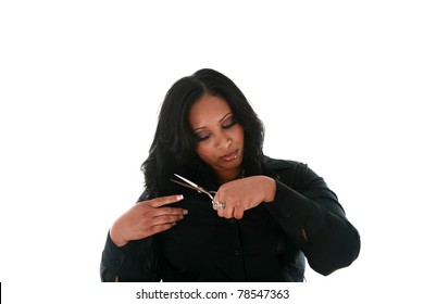 a beautiful african american woman trims her long black hair with scissors. isolated on white with room for your text.