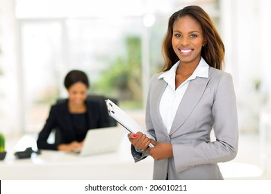 beautiful african businesswoman holding clipboard