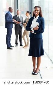 beautiful african businesswoman standing in modern office