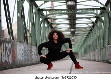 Beautiful African dancehall dancer on a bridge