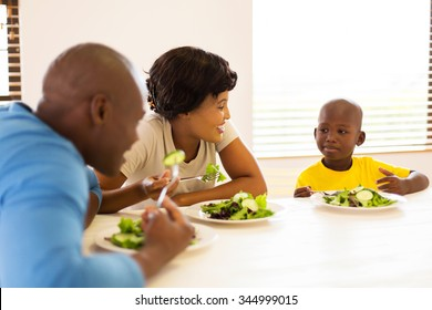 beautiful african family enjoying a healthy meal together at home