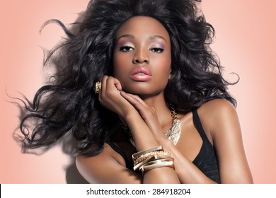 6e35c7eeb5a Beautiful African fashion model with long lush hairstyle and makeup.  African beauty and golden jewelry