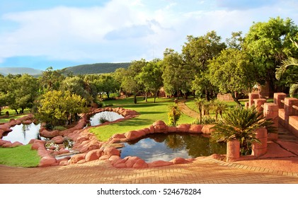 Beautiful African landscape of a lodge with a nice garden and lakes. Everything for your relaxation in a guesthouse. Amazing view. Travel and Vacation Awesome lodge in Africa.