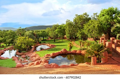 Beautiful African landscape of a lodge with a nice garden and lakes. Everything for your relaxation in a guesthouse. Amazing view. Travel & Vacation Awesome lodge in Africa.