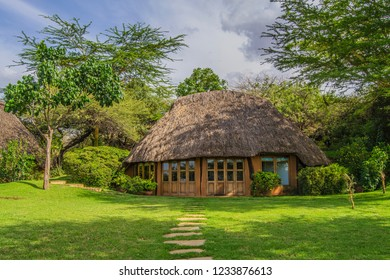 Beautiful African lodge with a green grass lawn