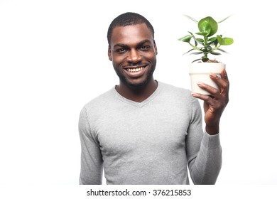 Beautiful african man with plant