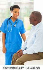 beautiful african medical doctor talking to senior man