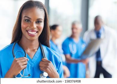 beautiful african medical nurse looking at the camera