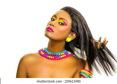 Beautiful African Model with dark skin, creative colorful rainbow make up and straight shiny hairstyle. Isolated, over white background with copy space.