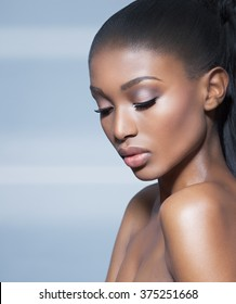Beautiful African model over blue background. Fashion and beauty with African dark skin model.