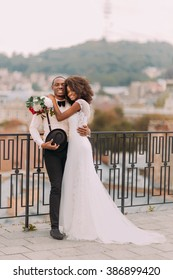 Beautiful african wedding couple standing on the balcony on their wedding day