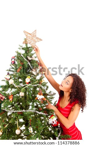 beautiful african woman decorating christmas tree - African Christmas Decorations