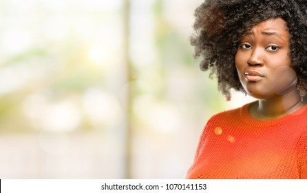 Beautiful african woman having skeptical and dissatisfied look expressing Distrust, skepticism and doubt, outdoor