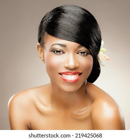 Beautiful african woman with healthy silky hair smiling.