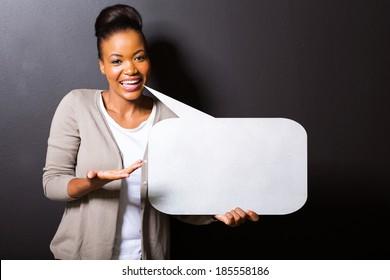 beautiful african woman holding speech bubble