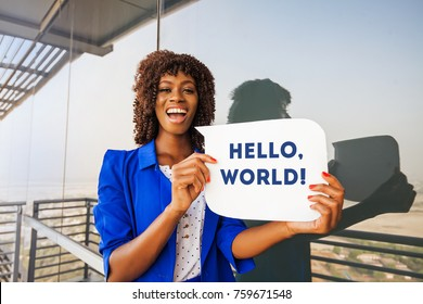 Beautiful African woman holding speech bubble