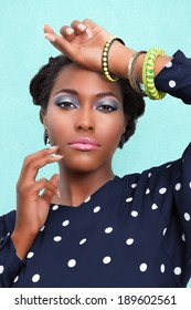 Beautiful African woman with pink lips and eye shadow makeup and jewelry
