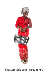 Beautiful African woman in red traditional clothing with wicker tote bag. Isolated on the white studio background