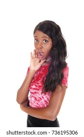 A beautiful African woman standing with her mouth open surprisedwith her hand on her face, isolated for white background