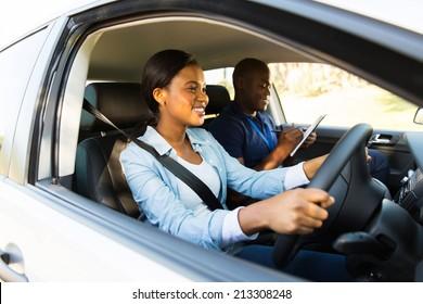 beautiful african woman taking driving test