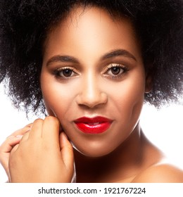 Beautiful african young woman with professional bright make-up, close-up beauty face