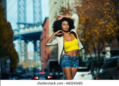 Beautiful afro american girl in vintage Brooklyn bridge area with Manhattan view