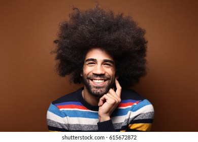 Beautiful afro man in front of a brown background