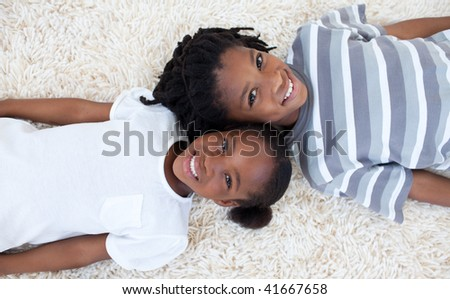 Beautiful Afro American Brother And Sister On Floor With Heads Together