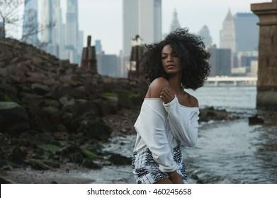 Beautiful afro-american girl in vintage Brooklyn bridge area with Manhattan view