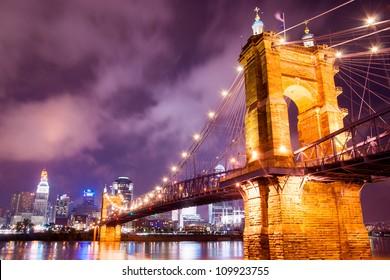 A beautiful aged bridge by the Cincinnati skyline