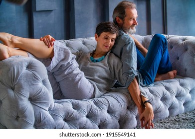 beautiful aged couple sitting on the sofa