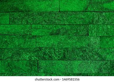 beautiful aged green natural quartzite stone bricks texture for design purposes.