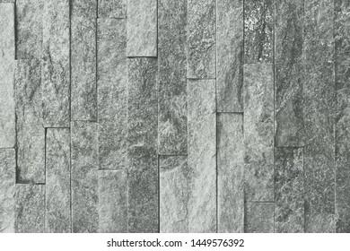 beautiful aged natural quartzite stone bricks texture for design purposes.