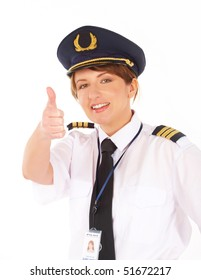 Beautiful airline pilot wearing uniform with epaulets showing thumb up gesture of approval, standing isolated on white background.
