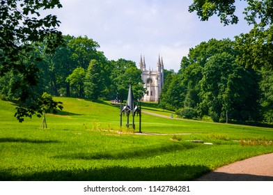 Beautiful Alexandria park with amazing emerald green lawn in the summer, Saint Petersburg, Russia
