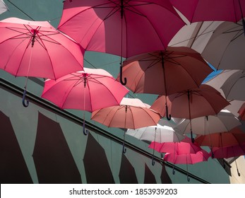 Beautiful alley at the shopping mall decorated with colorful umbrellas.