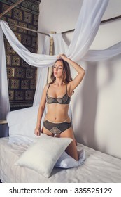 Beautiful alluring young woman in sexy lingerie. Perfect womans body