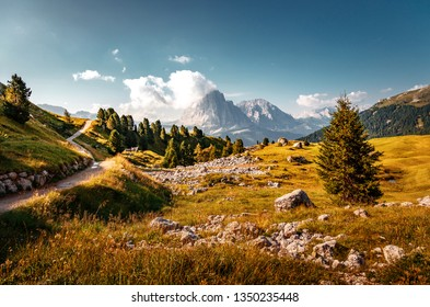Beautiful alpine countryside. Awesome Alpine landscape with traditional huts. Amazing Nature Scenery of Dolomites Alps. Epic Scene in the mountains place near Seceda peak. Val Gardena. Dolomiti alp.