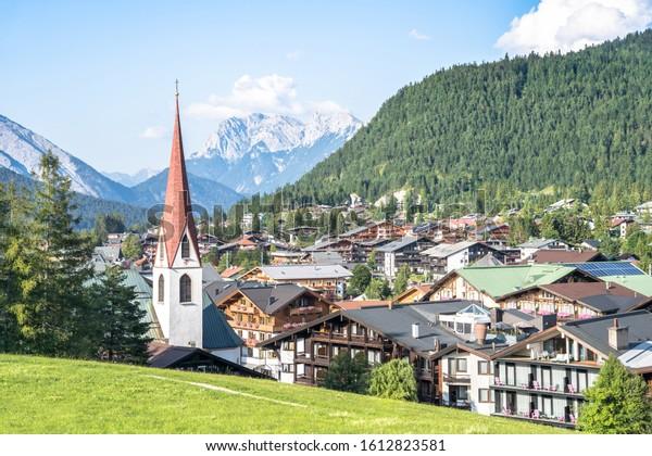 Beautiful alpine landscape with famous Pfarrkirche, Seefeld, Tirol, Austria