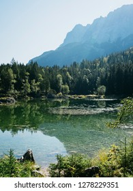 Beautiful Alpine landscape with mountains lake in sunny morning, Bavaria, Germany