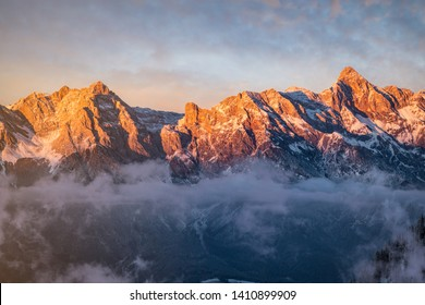 Beautiful alpine mountain scenery with clouds in the evening light