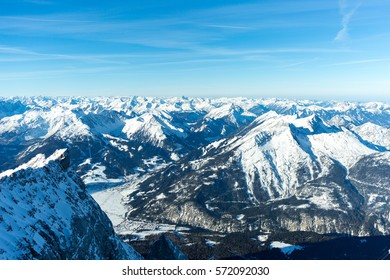 Beautiful alpine panorama as seen from Germany's tallest mountain, the Zugspitze, on a clear winter morning. The view includes famous mountains as Austria's Hochvogel and Switzerland's Piz Bernina.