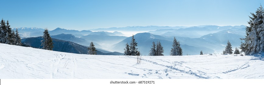 Beautiful  alpine panoramic view snow capped mountains, European beautiful winter mountains in Alps, Slope for cross country skiers in landscape